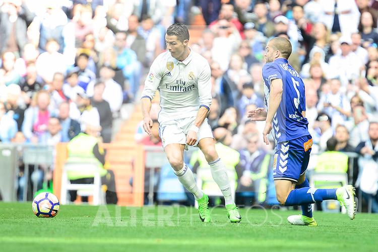 Real Madrid's Cristiano Ronaldo and Deportivo Alaves's Victor Laguardia during La Liga match between Real Madrid and Deportivo Alaves at Stadium Santiago Bernabeu in Madrid, Spain. April 02, 2017. (ALTERPHOTOS/BorjaB.Hojas)