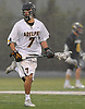 Chris Racalbuto #7 of Adelphi University carries downfield during a rain-filled first round game against Pace in the NCAA Division II Tournament at Motamed Field in Garden City, NY on Saturday, May 13, 2017.