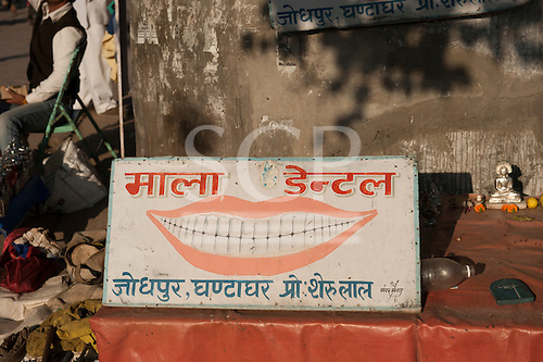 Jodhpur, India. Itinerant dentist's sign in the marketplace with the figure of the god Shiva.