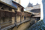 The Château de Chillon (Chillon Castle) is an island castle located on Lake Geneva, south of Veytaux in the canton of Vaud. It is situated at the eastern end of the lake, on the narrow shore between Montreux and Villeneuve, which gives access to the Alpine valley of the Rhone. The castle consists of 100 independent buildings that were gradually connected to become the building as it stands now. The rocky island on which the castle is built, was both a natural protection and a strategic location to control the passage between northern and southern Europe, Switzerland.