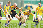 Darragh Long Austin Stacks in action against Maurice O'Connor and Brendan Guiney Feale Rangers in the Semi Finals of the Senior County Football Championship at Austin Stack Park on Sunday.