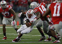 Rutgers Scarlet Knights running back Justin Goodwin (32) is tackled by Ohio State Buckeyes linebacker Curtis Grant (14) in the third quarter of their game at Ohio Stadium in Columbus, Ohio on October 18, 2014. (Columbus Dispatch photo by Brooke LaValley)