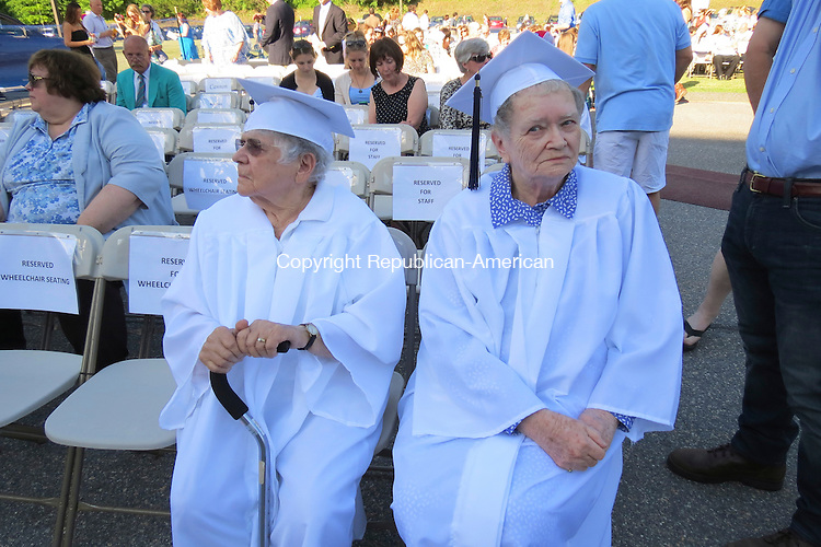 FALLS VILLAGE,CT - 20_NEW_061914RE05 - Helen Wike Humeston, left, of Sharon, and Frances Buckbee Wohlfert of Canaan are members of the first graduating class in 1940 of Housatonic Valley Regional High School. They were invited to attend Thursday's graduation as part of the school's 75th anniversary celebration this year. Ruth Epstein Republican-American