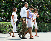 Washington, D.C. - August 1, 2009 -- United States President Barack Obama and his family depart the South Lawn of the White House en route to Camp David on Saturday, August 1, 2009.  From left to right: Marian Robinson, mother-in-law; President Obama; first lady Michelle Obama; and Malia Obama..Credit: Ron Sachs / Pool via CNP