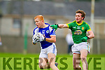 Templenoe's Teddy Doyle and Curraha's Phelim Dowling in the AIB GAA Football All Ireland Junior Club Championship.