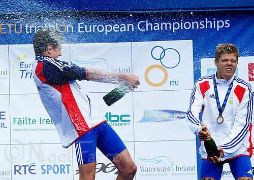 04 JUL 2010 - ATHLONE, IRL - Alistair Brownlee (GBR) (left) celebrates his victory at the  European Elite Mens Triathlon Championships with bronze medallist David Hauss (FRA) .(PHOTO (C) NIGEL FARROW)