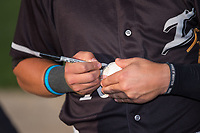 Mitch Roman (10) of the Kannapolis Intimidators autographs a baseball for a fan prior to the game against the Hickory Crawdads at Kannapolis Intimidators Stadium on May 18, 2017 in Kannapolis, North Carolina.  The Crawdads defeated the Intimidators 6-4.  (Brian Westerholt/Four Seam Images)