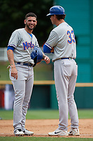 Midland RockHounds Luis Barrera (22) and manager Scott Steinmann (33) during a Texas League game against the Frisco RoughRiders on May 21, 2019 at Dr Pepper Ballpark in Frisco, Texas.  (Mike Augustin/Four Seam Images)