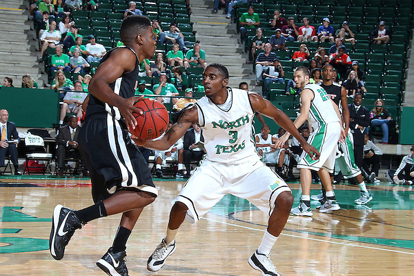 Denton, TX - NOVEMBER 1:  Alzee Williams #3 of the North Texas Mean Green guards against East Central University Tigers at the Super Pit in Denton, TX on November 1, 2012 in Denton, Texas. (Photo by Rick Yeatts)