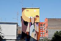 Straniera, Artista Alexy Lika<br /> Title Foreigner artist Alexy Lika<br /> Alexy Lika, tra i giovani artisti più' promettenti della scena russa, traduce una formazione da architetto. Geometrie pure, destrutturazione delle forme, rapporti rigorosi tra i colori<br /> Roma 01-02-2015 Street Art a Roma. In vari quartieri di Roma e' fiorita la Street Art, con splendidi murales che hanno lo scopo di raccontare delle storie della citta', di commemorare dei momenti importanti, o semplicemente di interpretarla.<br /> Street Art in Rome. Very important writers  painted Murales in various districts of Rome to tell stories about the city, to commemorate important moments, to embellish the quarter or simply to portray it.  <br /> Photo Samantha Zucchi Insidefoto