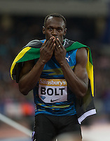 Usain BOLT of Jamaica (Men's 100m) blows kisses to the crowd during the Sainsburys Anniversary Games Athletics Event at the Olympic Park, London, England on 24 July 2015. Photo by Andy Rowland.