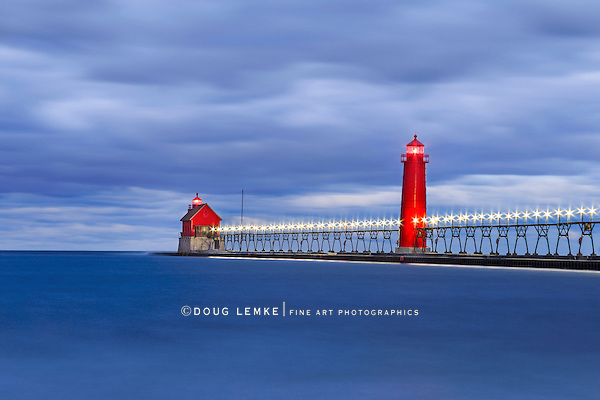 Motion blurred water at the Grand Haven South Pierhead Lighthouse before sunrise, Grand Haven Michigan, USA