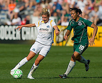 Los Angeles Sol midfielder Aly Wagner (4) works the ball away from St Louis Athletica midfielder Daniela Alves (10) during a WPS match at Hermann Stadium, in St. Louis, MO, April 25 2009. The match ended in a 0-0 tie.