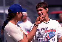 NASCAR driver Adam Petty (right), shown talking with his father Kyle Petty in this file photo from September 1999, was killed in a racing crash at Loudon, NH on Friday, 5/12/00.  The fourth-generation stock car driver was 19 years old. (Photo by Brian Cleary)