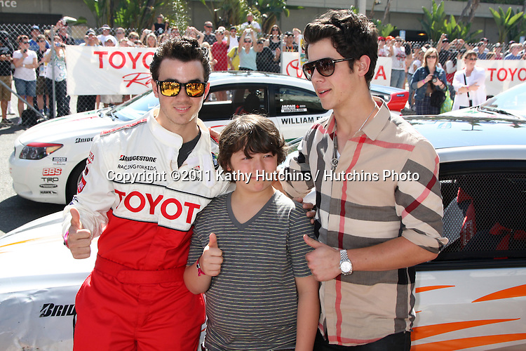 LOS ANGELES - APR 16:  Kevin Jonas , Frankie Jonas, Nick Jonas  at the Toyota Grand Prix Pro Celeb Race  at Toyota Grand Prix Track on April 16, 2011 in Long Beach, CA.