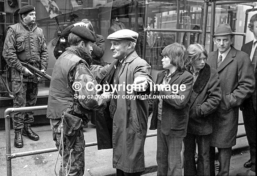 Civilians are searched by soldiers at one of the numerous security gates into the main city centre shopping area in Belfast, N Ireland, during the Troubles. 197403210168g.<br />