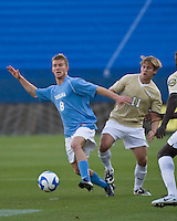 North Carolina midfielder Garry Lewis (8) and Wake Forest midfielder Jamie Franks (11)  fight for the ball.  North Carolina Tar Heels defeated Wake Forest Demon Deacons 1-0 in the semifinal match of the NCAA Men's College Cup at Pizza Hut Park in Frisco, TX on December 12, 2008.  Photo by Wendy Larsen/isiphotos.com