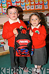 HELPING: Do?nal Crean helping Judith Waugh with her school bags on her first day at Derry Quay National School, Annagh, on Friday......... ...... ..DANCING: Denise McEvoy Tralee who danced the night away at her 30th Birthday Party in the KOR GAA & Hurling Club, Strand Road, Tralee(Denise is seated centre). .... ..   Copyright Kerry's Eye 2008