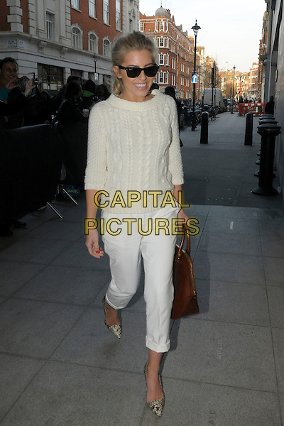 Mollie King .The Saturdays arriving at BBC Radio 1, London, England..4th March 2013.full length white sweater jumper top knitted cropped trousers rolled turned up brown leather jacket snakeskin print shoes sunglasses shades.CAP/IA.©Ian Allis/Capital Pictures.
