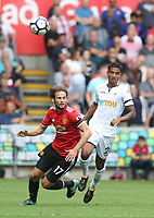 Daley Blind of Manchester United chases the ball after a clearance fromKyle Naughton of Swansea City during the Premier League match between Swansea City and Manchester United at The Liberty Stadium, Swansea, Wales, UK. Saturday 18 August 2017