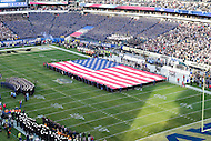 "PHILADELPHIA, PA. - DEC 12 2015: An American flag is displayed as the National Anthem is sang during the pre-game ceremony of ""America's Game"" Army vs. Navy at Lincoln Financial Field Philadelphia, PA. (Photo by Phil Peters/Media Images International)"