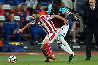 Cheikhou Kouyate of West Ham United and Erik Pieters of Stoke City during West Ham United vs Stoke City, Premier League Football at The London Stadium on 16th April 2018