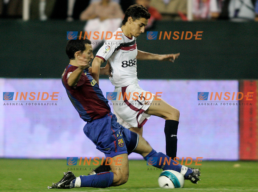 Sevilla's Jesus Navas (r) and FC Barcelona's Gianluca Zambrotta (l) during the Spanish League match between Sevilla  and FC Barcelona at Ramon Sanchez Pizjuan Stadium in Sevilla, Saturday March 03 2007. (INSIDE/ALTERPHOTOS/B.Echavarri). Siviglia Barcellona