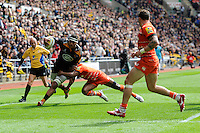Nathan Hughes of Wasps is tackled by Vereniki Goneva of Leicester Tigers