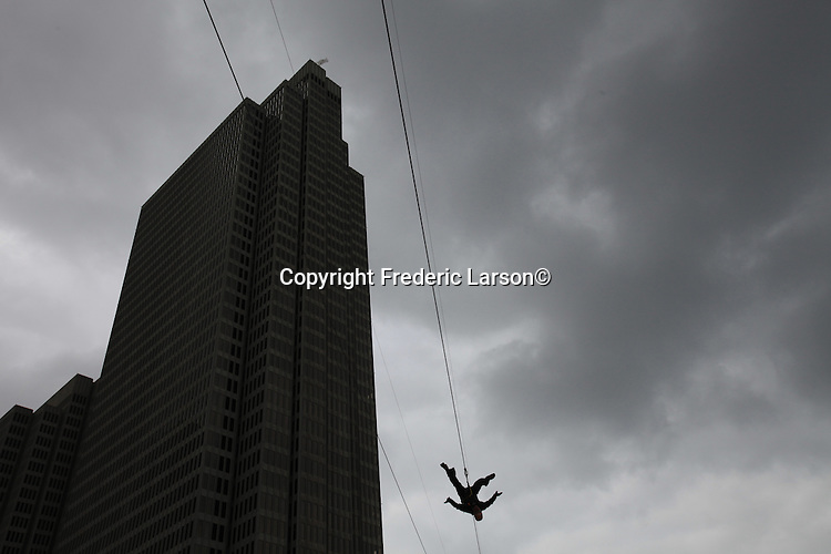 Zip lining over the Embarcadero in San Francisco, California.