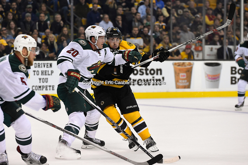 Thursday, November 19, 2015: Boston Bruins left wing Brad Marchand (63) and Minnesota Wild defenseman Ryan Suter (20) in game actioin during the National Hockey League game between the Minnesota Wild and the Boston Bruins held at TD Garden, in Boston, Massachusetts. The Bruins defeat the Wild 4-2. Eric Canha/CSM