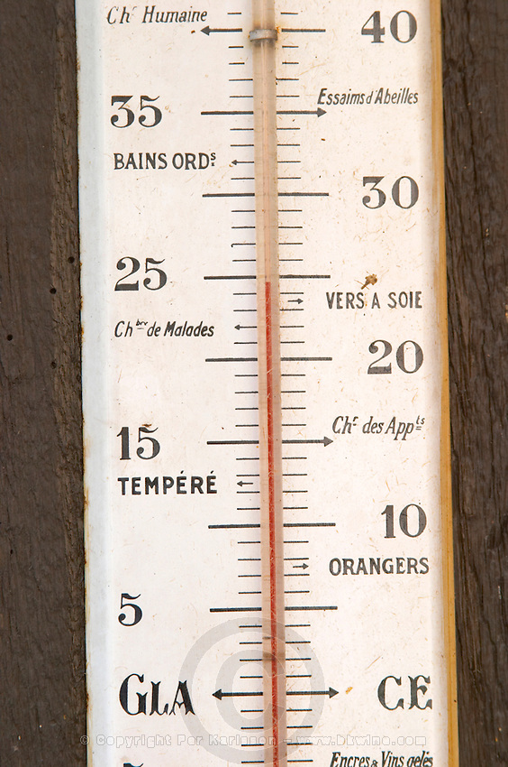 Old thermometer on the wall. Marked with Bath Water, Silk Worms, Orange Trees, and other strange words. Domaine Marc Kreydenweiss, Andlau, Alsace, France