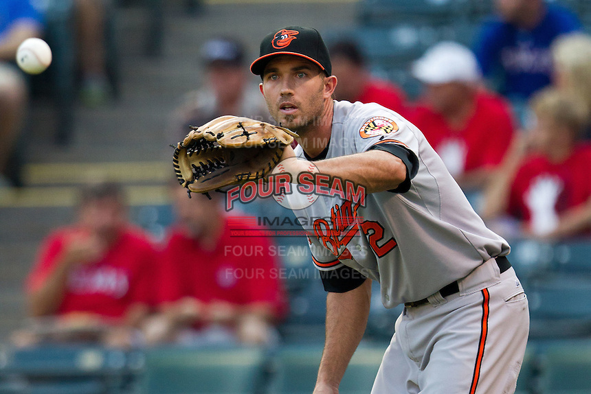 Baltimore Orioles shortstop JJ Hardy #2 warms up before the Major League Baseball game against the Texas Rangers on August 21st, 2012 at the Rangers Ballpark in Arlington, Texas. The Orioles defeated the Rangers 5-3. (Andrew Woolley/Four Seam Images)..