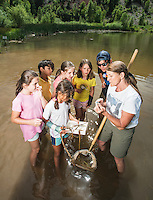 Vicki Phelps (cq) helps with a watershed education outreach class for young children, at the San Miguel River Colorado, Monday, July 6, 2015. <br /> <br /> Photo by Matt Nager