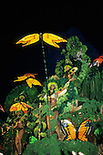Rio de Janeiro, Brazil. Carnival float with brightly coloured butterfly and rainforest theme.