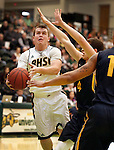 SPEARFISH, SD - JANUARY 8, 2016 -- Wyatt Krogman #11 of Black Hills State drives to the basket against Regis defenders during their college basketball game Saturday at the Donald E. Young Center in Spearfish, S.D. (Photo by Dick Carlson/Inertia)
