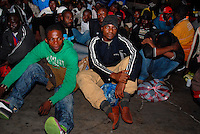 Lampedusa / Italia - 22 giugno 2011.Due barche con 400 immigrati giunti nella notte al porto dell'isola di Lampedusa scortati da una motovedetta della Guardia Costiera. Gli immigrati provengono dalla Libia e varie zone dell'Africa sub-Sahariana..Foto Livio Senigalliesi..Lampedusa Italy - June 22 2011.More than 400 immigrants, including women and children, landed on the southern Italian island of Lampedusa overnight..The migrants, believed to be from countries in sub-Saharan Africa, arrived on two boats that are believed to have left from the Libyan coast..Photo Livio Senigalliesi