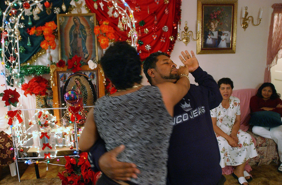 Journal photo by Ted Richardson: Biterbo Calleja Garcia, who arrived in Winston-Salem in 1979 to work tobacco fields on Union Cross Rd. and who was likely the first Mexican to work in the area, dances at a friend's house on the eve of the 12th of December near a shrine to the Virgin of Guadalupe.