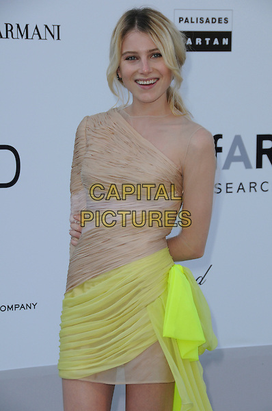 DREE HEMINGWAY.arrivals at amfAR's Cinema Against AIDS 2010 benefit gala at the Hotel du Cap, Antibes, Cannes, France during the Cannes Film Festival.20th May 2010.amfAR half length beige neon yellow dress ruched silk mini one shoulder nude sleeve .CAP/CAS.©Bob Cass/Capital Pictures.