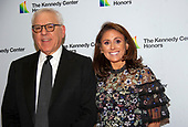 David M. Rubenstein, Chairman, John F. Kennedy Center for the Performing Arts and his daughter, Ellie, arrive for the formal Artist's Dinner honoring the recipients of the 42nd Annual Kennedy Center Honors at the United States Department of State in Washington, D.C. on Saturday, December 7, 2019. The 2019 honorees are: Earth, Wind & Fire, Sally Field, Linda Ronstadt, Sesame Street, and Michael Tilson Thomas.<br /> Credit: Ron Sachs / Pool via CNP