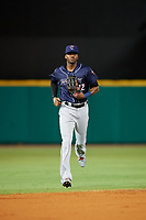 Jacksonville Jumbo Shrimp center fielder Lewis Brinson (32) jogs off the field during a game against the Pensacola Blue Wahoos on August 15, 2018 at Blue Wahoos Stadium in Pensacola, Florida.  Jacksonville defeated Pensacola 9-2.  (Mike Janes/Four Seam Images)