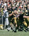 Purdue Boilermakers Bob Griese (12) during a game from his 1965 season with the Purdue Boilermaker. Bob Griese went on to play in the NFL  for 14 seasons, all with the Miami Dolphins, was a 8-time Pro Bowler and was inducted to the Pro Football Hall of Fame in 1990.(SportPics)