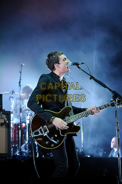 Miles Kane <br /> performing in concert, Brixton Academy, London, England,<br /> UK, 11th October 2013.<br /> music live on stage gig on stage half length microphone singing playing guitar black suit playing <br /> CAP/MAR<br /> &copy; Martin Harris/Capital Pictures