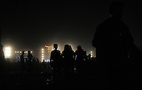 21st Wacken Open Air WOA  (5.8. - 7.8.2010) in Wacken (Germany , Schleswig-Holstein) - nearly 85000 metalheads celebrate their Mekka of metal - in picture: atmosphere in the night  //  im Bild: Atmosphäre in der Nacht - im Hintergrund die Bühnen / Silhouetten von Besuchern . Foto: Norman Rembarz..Norman Rembarz , Autorennummer 41043728 , Augustenstr. 2, 04317 Leipzig, Tel.: 01794887569, Hypovereinsbank: BLZ: 86020086, KN: 357889472, St.Nr.: 231/261/06432 - Jegliche kommerzielle Nutzung ist honorar- und mehrwertsteuerpflichtig! Persönlichkeitsrechte sind zu wahren. Es wird keine Haftung übernommen bei Verletzung von Rechten Dritter. Autoren-Nennung gem. §13 UrhGes. wird verlangt. Weitergabe an Dritte nur nach  vorheriger Absprache..