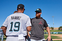 Salt River Rafters pitcher Cody Reed (13), of the Arizona Diamondbacks organization, celebrates with coach Luis Ramirez (19) after winning the Arizona Fall League Championship Game against the Surprise Saguaros on October 26, 2019 at Salt River Fields at Talking Stick in Scottsdale, Arizona. The Rafters defeated the Saguaros 5-1. (Zachary Lucy/Four Seam Images)