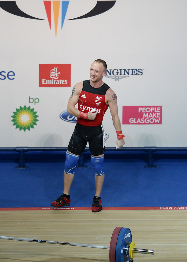 Photographer Ian Cook/CameraSport<br /> <br /> 20th Commonwealth Games - Weightlifting - Men's 62Kg -  Day 2 - Friday 25th July 2014 - Glasgow - UK<br /> <br /> &copy; CameraSport - 43 Linden Ave. Countesthorpe. Leicester. England. LE8 5PG - Tel: +44 (0) 116 277 4147 - admin@camerasport.com - www.camerasport.com