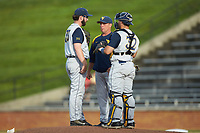 West Virginia Mountaineers pitching coach Derek Matlock has a meeting on the mound with starting pitcher BJ Myers (33) and catcher Ivan Gonzalez (32) during the game against the Wake Forest Demon Deacons in Game Six of the Winston-Salem Regional in the 2017 College World Series at David F. Couch Ballpark on June 4, 2017 in Winston-Salem, North Carolina. The Demon Deacons defeated the Mountaineers 12-8. (Brian Westerholt/Four Seam Images)