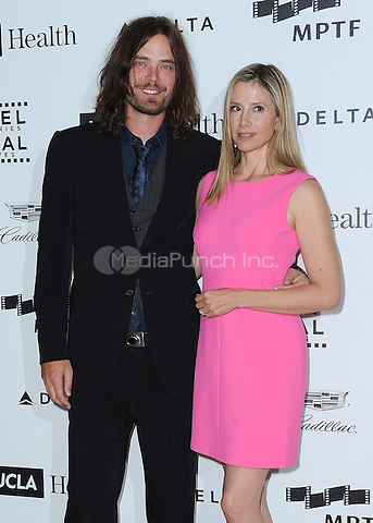 LOS ANGELES, CA - APRIL 25:  Mira Sorvino and Christopher Backus at the 4th Annual Reel Stories, Real Lives Benefit at Milk Studios on April 25, 2015 in Los Angeles, California. Credit: mpiPGSK/MediaPunch