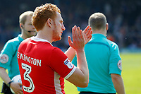 Dean Lewington of MK Dons salutes fans on his 700th professional appearance during the Sky Bet League 1 match between Southend United and MK Dons at Roots Hall, Southend, England on 21 April 2018. Photo by Carlton Myrie.