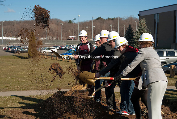 NAUGATUCK, CT 02 APRIL 2013--040213JS03--Naugatuck High School students, along with principal Jan Saam, right, toss shovels full of dirt during a ground breaking ceremony for the $81 million Naugatuck High School renovation project Tuesday at the school..Jim Shannon Republican-American.