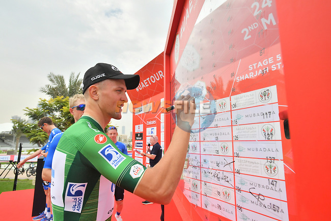 Green Jersey Stepan Kuriyanov (RUS) Gazprom–Rusvelo at sign on before the start of Stage 5 of the 2019 UAE Tour, running 181km form Sharjah to Khor Fakkan, Dubai, United Arab Emirates. 28th February 2019.<br /> Picture: LaPresse/Massimo Paolone | Cyclefile<br /> <br /> <br /> All photos usage must carry mandatory copyright credit (© Cyclefile | LaPresse/Massimo Paolone)
